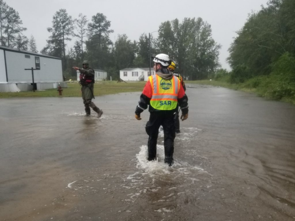 A Search & Rescue team member makes his way through floodwaters in Lumberton.